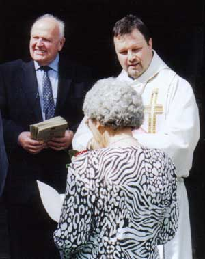 The vicar with Margaret & the service sheets.